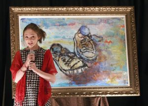 Autumn de Forest speaks to collectors during a Park West event in Boston. Photo courtesy of the Boston Globe.