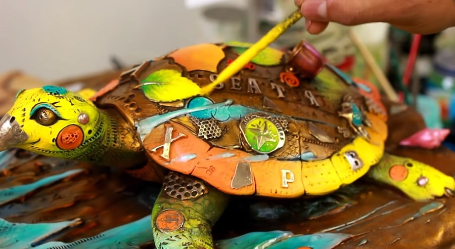 Patinas are hand-painted into the sculptures and then cooked on with a blowtorch.
