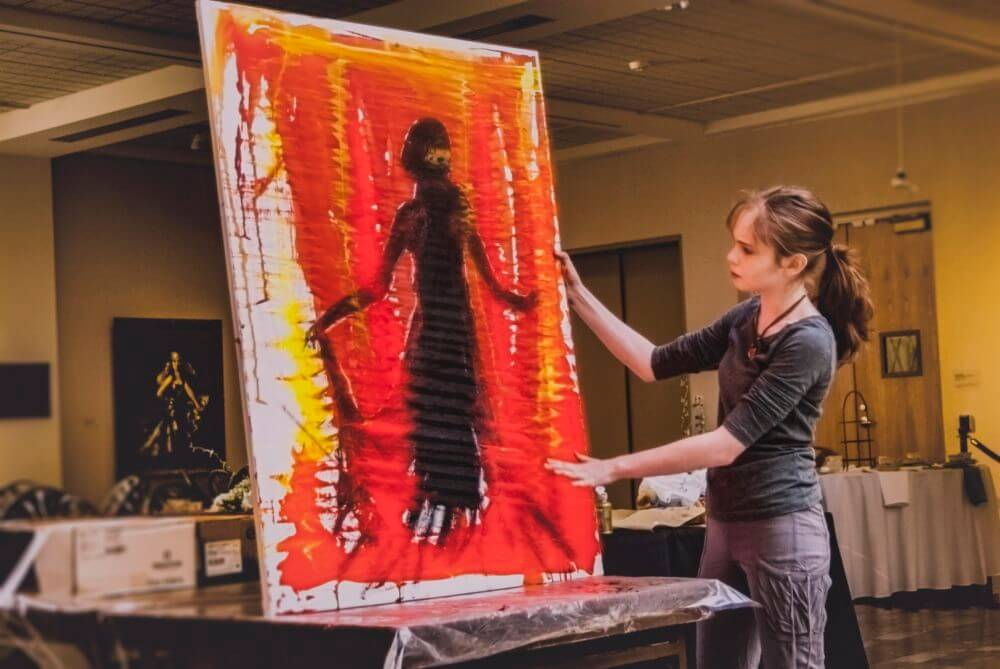 Autumn de Forest demonstrating a painting technique at the Butler Institute of American Art (Photo courtesy of Carole Sorrell)
