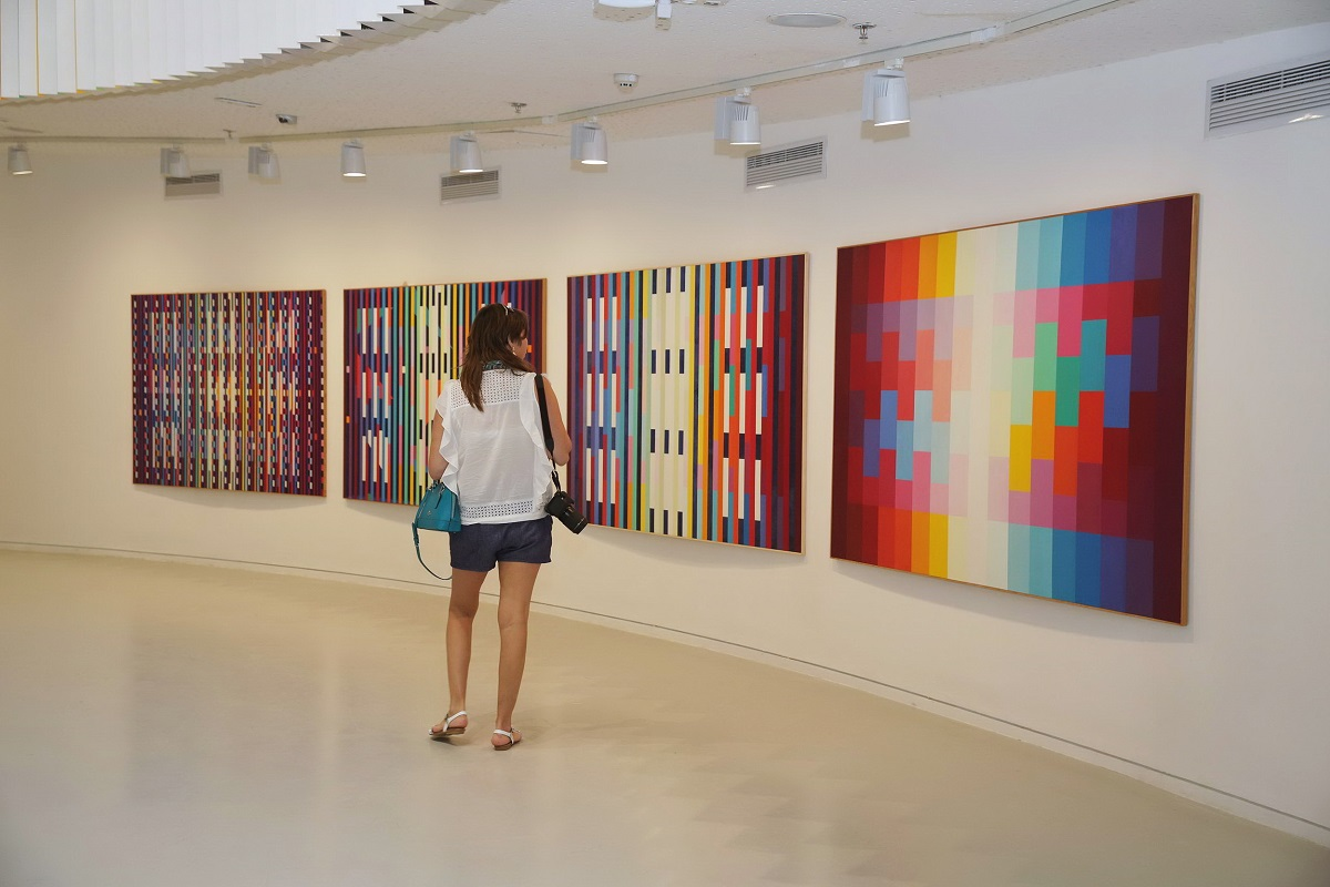 Park West Gallery guest browses the collection at the opening of the Yaacov Agam Museum of Art in Israel, 2017, Year of Art.