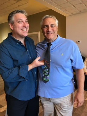 Artist Alexandre Renoir (left) created a one-of-a-kind hand-painted tie for Steve Miller (right) during one of their VIP art cruises.