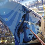 The finishing touches being out on Wyland's hull mural for Norwegian Bliss (Image courtesy of Meyer Werft)