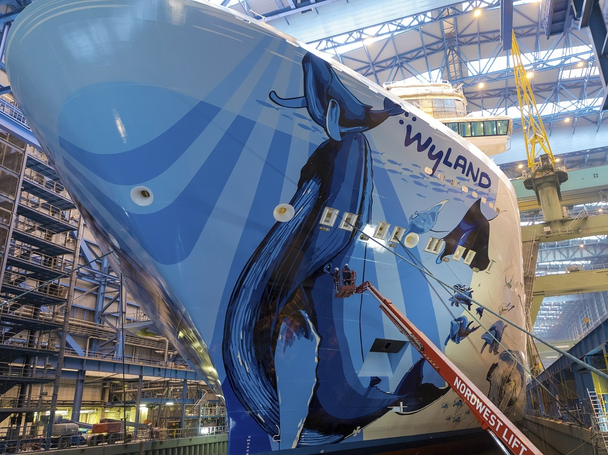 The finishing touches being put on Wyland's hull mural for Norwegian Bliss (Image courtesy of Meyer Werft)