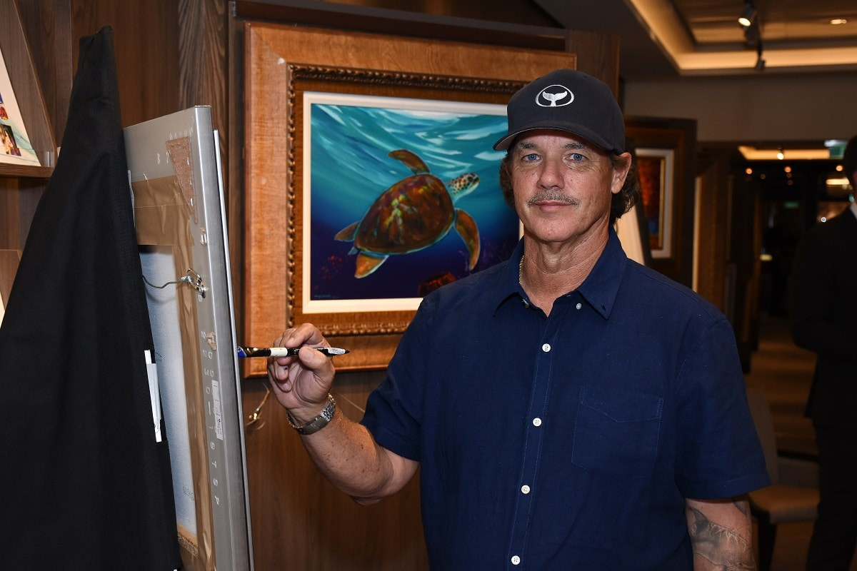 Wyland painting on board Norwegian Bliss, 2018. Wyland art