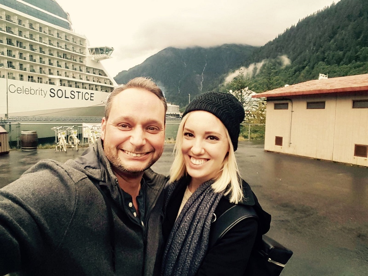 Auctioneer Spotlight: Ty and Gracie Braga in front of the Celebrity Solstice.