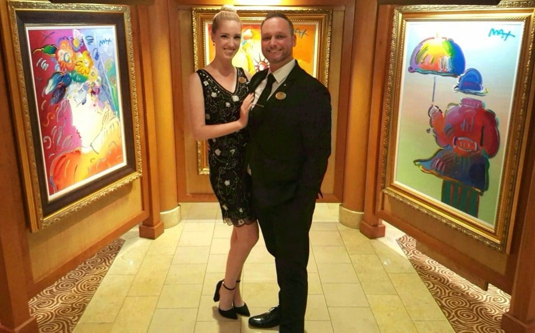 Auctioneer Spotlight: Ty and Gracie Braga, posing in one of Park West's onboard art galleries.