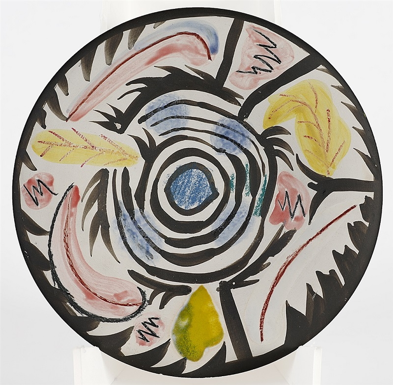 """Motifs No. 17"" (1963), Pablo Picasso. White earthenware clay round plate with colored ceramic pastels and glazed. From the Picasso Ceramics collection at Park West Gallery."