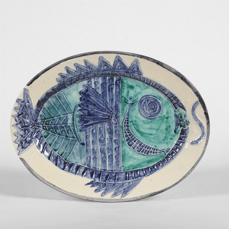 """Poisson de Profil"" (Fish in Profile; 1951), Pablo Picasso. White earthenware clay oval dish with colored engobe and glaze. From the Picasso Ceramics collection at Park West Gallery."
