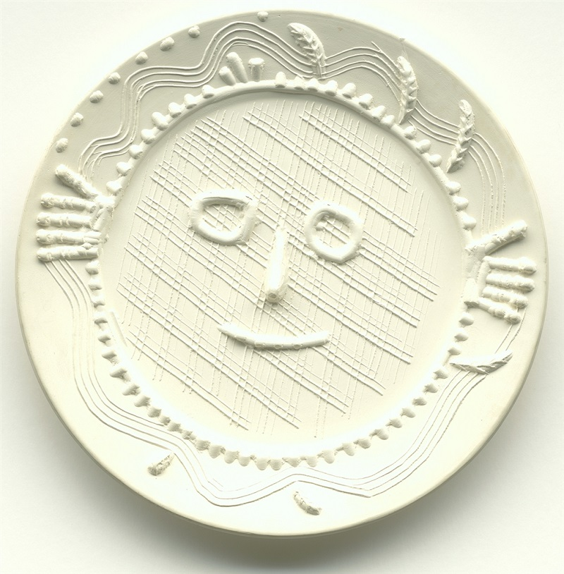 """Visage aux Mains"" (Face with Hands; 1956), Pablo Picasso. White earthenware clay round dish. From the Picasso Ceramics collection at Park West Gallery"