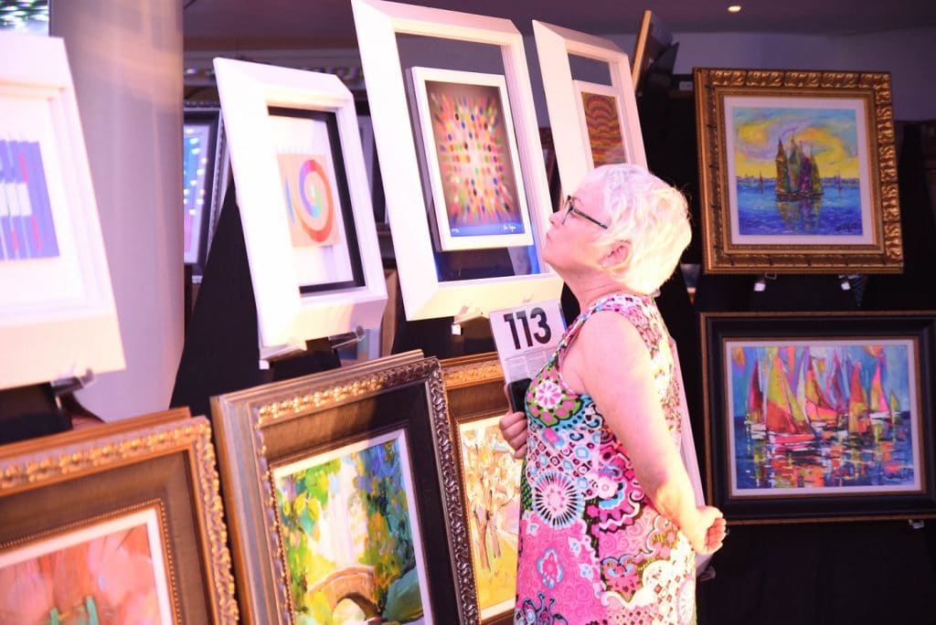 Guest browses Celebrity Edge's art collection.