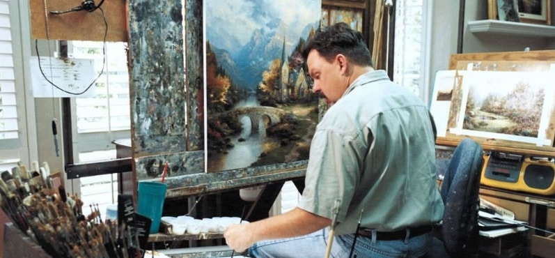 Thomas Kinkade at work in his studio.