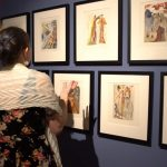 "Patrons browse Dalí's illustrations at the ""Stairway to Heaven"" opening at the Oglethorpe University Museum of Art."