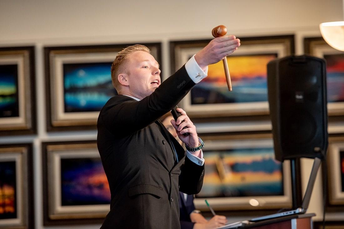 Auctioneer Matt Whittam gets the bidding started.