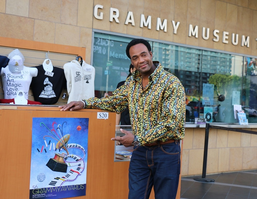 Glenn poses with his artwork in front of the Grammy Museum