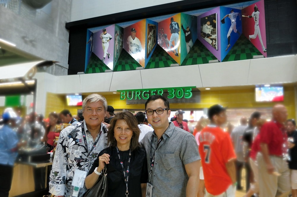 "The Pangborn family posing in front of Dominic's ""Art in Motion"" at Marlins Park."