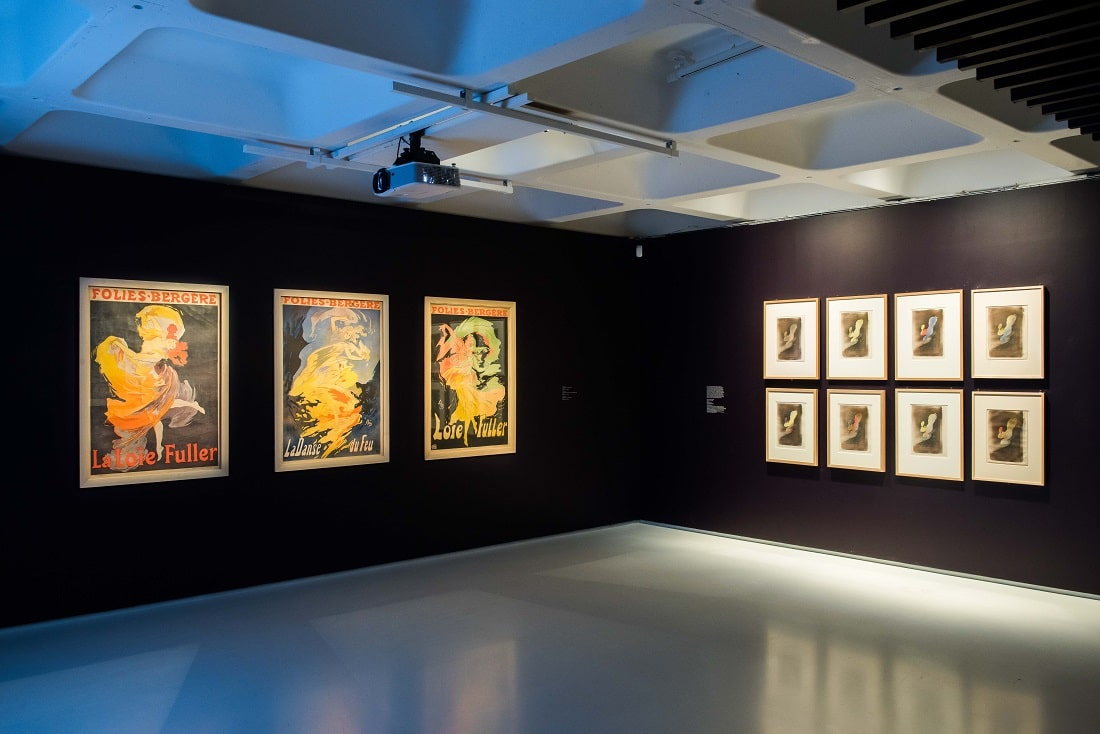 "Toulouse-Lautrec's ""Miss Loïe Fuller"" lithographs share gallery space at the Barbican with other posters promoting Fuller's elaborate performances. Photo credit © Max Colson"