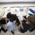 Local schoolchildren on a field trip enjoy Park West's collection of Picasso ceramics.