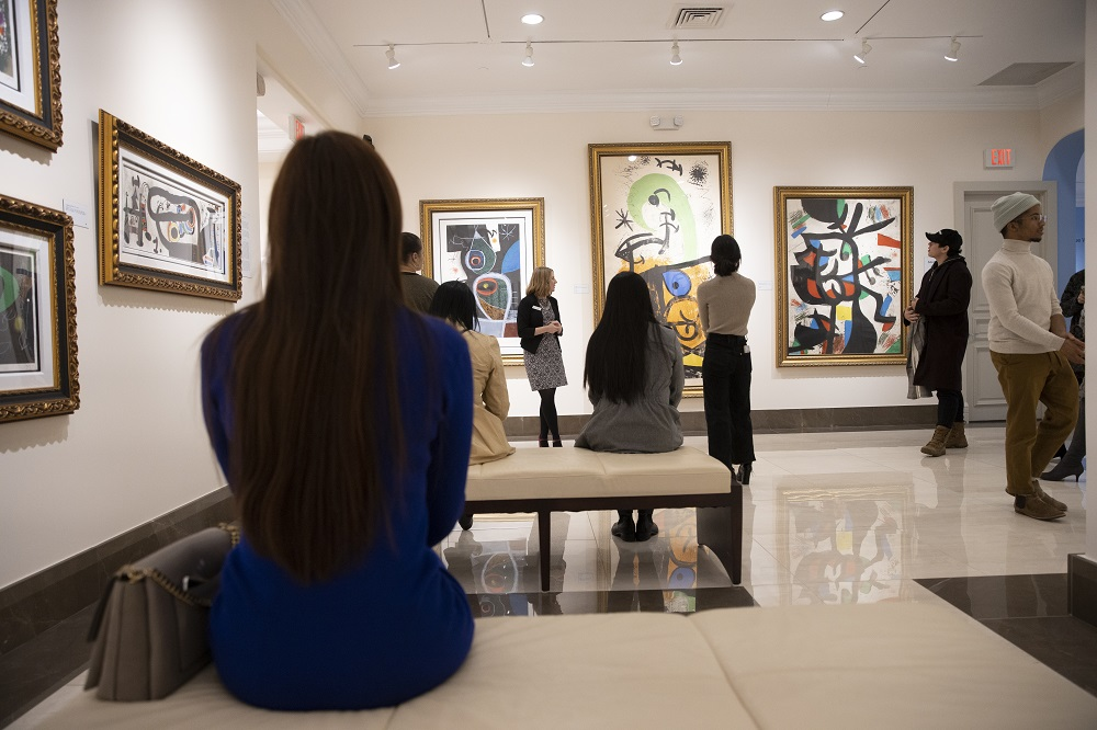 A museum tour group learns about the unique style of Spanish artist Joan Miró.