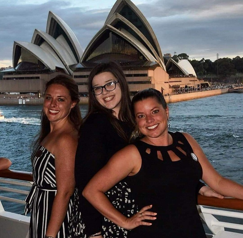 Gandy and some of her Park West co-workers pose in front of the Sydney Opera House.