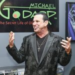 """Michael Godard addresses the crowd at the grand opening of """"The Secret Life of Olives."""""""