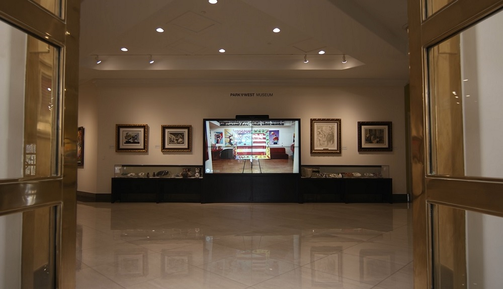 As you enter Park West Museum, you are greeted by one of Park West's interactive digital art walls.