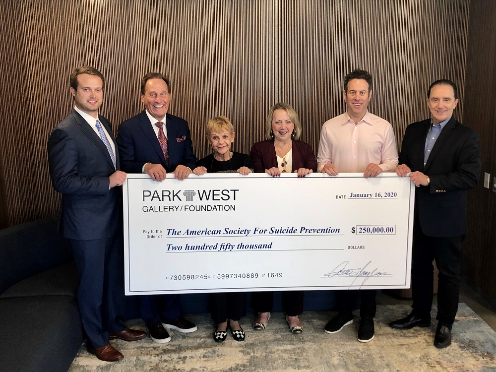 Representatives from Park West Gallery and the Park West Foundation present their donation check to Robert Gebbia, CEO of the American Foundation for Suicide Prevention. (Pictured left to right: Michael Karay, Park West's Associate Vice President of Merchandising; Albert Scaglione, Park West's Founder and CEO; Mitsie Scaglione, Park West's Corporate Secretary; Diane Pandolfi, Director of the Park West Foundation; Marc Scaglione, President of Park West Gallery; and Robert Gebbia.)