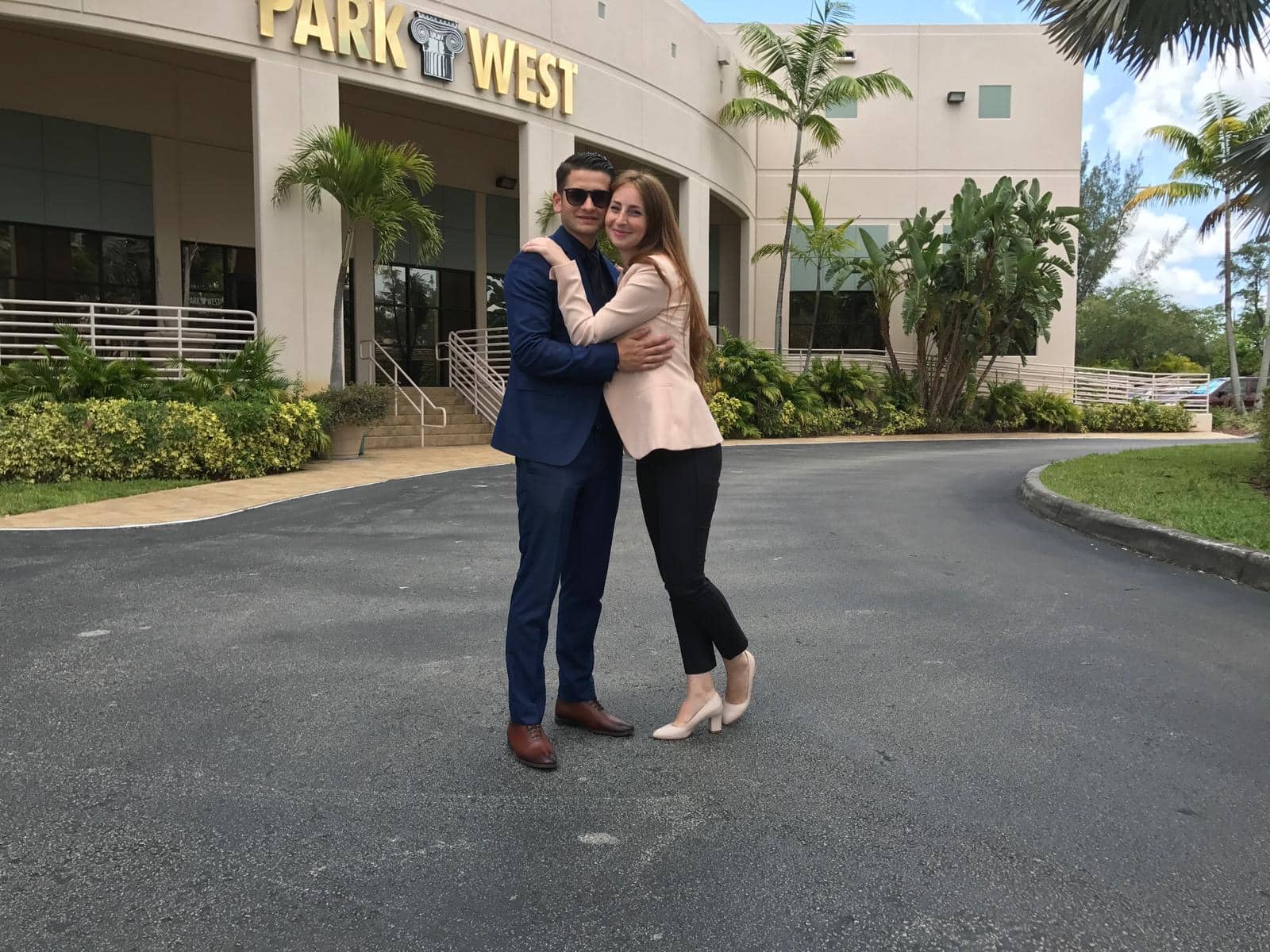 Park West Gallery Auctioneers Sergiu Miron and Alexandra Dima in front of Park West's Miami Lakes location