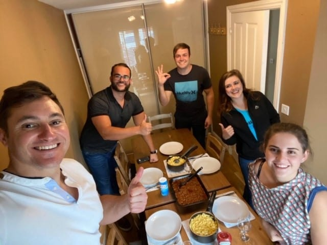 The group enjoys a dinner at their London rental home.