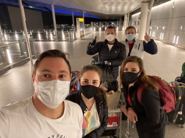 """The """"London 5"""" take a group picture at the airport."""